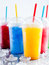 Colorful Frozen Fruit Slush Drinks in Plastic Cups