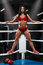 Sexy fitness girl showing muscular athletic body, abs. Muscular woman in the boxing ring