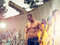 Young fit macho man posing in front of graffiti wall