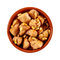 Spicy marinated chicken pieces with pine nuts