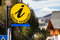 Round yellow sign and arrow Tourist information in German language