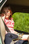 Child in car. Holidays vacation trip travel.