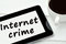 The words Internet crime on tablet pc