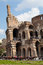 The Colosseum. Walking tour. Tourists and chariot
