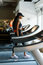 Running on treadmill in gym or fitness club - black woman exercising to gain more fit