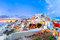 Panorama of Oia or Ia at sunset, Santorini, Greece
