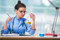 The woman doctor doing chemical tests in laboratory