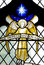 An angel with the star of Bethlehem in stained glass