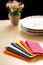 Colorful paper table napkins, flowers and plates