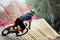 Athlete man extreme cyclist riding Insloped Turn