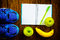 Sport shoes, apples and bananas on a wooden background. Sport