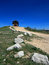 Cement Ridge Fire Lookout Tower with limestone granite boulders lining dirt road in the Black Hills of South Dakota
