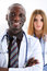 Group of smiling friendly medicine doctors look in camera