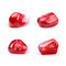 Four perfect pomegranate seeds, isolated
