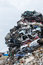 Dumping ground. Scrap metal heap. Compressed crushed cars is returned for recycling.