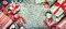 Christmas background with handmade paper snowflakes, gift boxes and red decorations on rustic background, top view