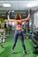 Fitness, sport, exercising lifestyle - woman with dumbbells doing exercises in gym