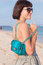 Fashionable young woman with tattoo on her back in black and white clothes with a luxury snakeskin handbag on the