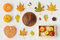 Thanksgiving holiday objects for mock up template design. Autumn pumpkin and fall leaves. View from above.