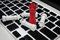 Online business strategy with chess king on keyboard