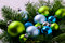 Christmas background with blue and green ornaments