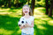 Adorable little soccer fan cheering on hot summer day at park