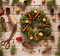 Advent Christmas wreath decoration with natural decorations, pine cones spruce, nuts, candied fruit on wooden background