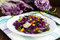 Fresh vitamin fitness salad of red cabbage, bell peppers, corn, arugula.