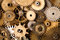 Steampunk gears background. Aged mechanical clock wheels close-up. Shallow depth of field, soft focus