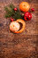 Red Christmas ornaments, food decor and fir tree branch on a rustic wooden background. Xmas card. Happy New Year. Top view