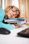 Funny portrait of disheveled young woman sleeping on books