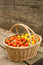 Wooden basket of colourful organic tomatoes and produce