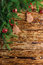 Christmas background. Fir branches, red balls, gingerbread on the old brown boards. Rustic style. Copy space