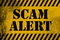 Scam alert sign yellow with stripes