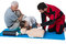 Paramedic training cardiopulmonary resuscitation to senior man and girl