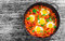 Delicious shakshuka - fried eggs, onion,bell peppers,tomatoes an