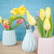 Spring flowers in little vases