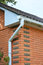 Brick House Rain Gutter Pipeline Outdoor. Home Guttering, Gutters, Plastic Guttering System, Guttering & Drainage Pipe Exterior
