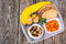 Health and Fitness food in lunch box on wooden background