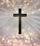 Jesus Christ wooden cross and He is risen text for Easter