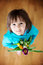 Little child, holding bouquet of tulips