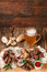 Grilled meat served with beer on rustic table