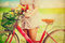 Women lifestyle in spring with colorful flowers in basket of red bicycle