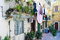 Courtyard with balcony, plants and laundry in Taormina at Sicilian Island