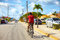 BAVARO, DOMINICAN REPUBLIC - 09.01.2015: Undefined man riding on bicycle along the Bavaro city road