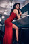 Gorgeous beauty young brunette woman in red dress