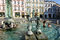 Olomouc, Czech Republic. Hot summer day kids are playing in the fountain pool at Old Town Square.