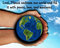 A graphic illustration of a pair of hands hold the earth