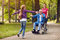 Cheerful disabled grandfather enjoying with his granddaughter an