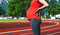 Close-up belly of pregnant woman on sport stadium.